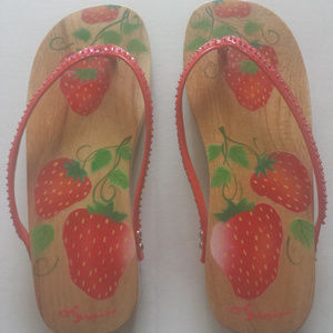Wooden flip flops...9 inches long..